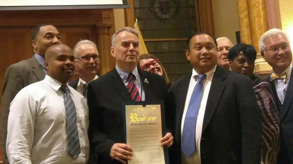 Simon Pereira Shorey receiving a Resolution of Commendation from the assembled City Council